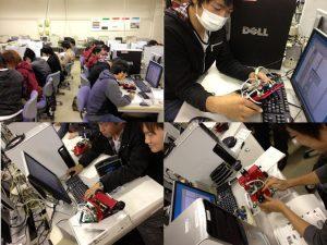 ロボットとマイコンプログラムの設計・製作を行っている様子